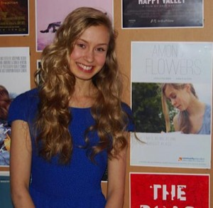 """With the """"Among Flowers"""" poster at the Nashville Film Festival."""